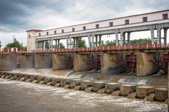 Dam and water storage doors on hydro power plant Royalty Free Stock Image