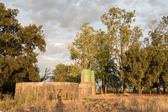 Dam, water tanks and trees Stock Images