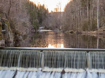 Dam with waterfall at Nes Verk Iron Works Museum in Tvedestrand Norway. Dam and waterfall at Nes Verk Iron Works Museum in Tvedestrand Norway Royalty Free Stock Image