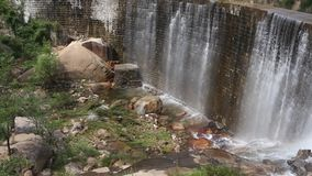Dam and waterfall. The river overflowed the dam and formed a waterfall. The scenery was spectacular stock video