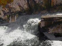 Dam waterfall. Water cascade streaming down in a rainy season Royalty Free Stock Photos