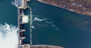 Dam and waterfalls on river. Top view. Aerial shot. stock video