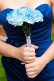 Dama de honra com flores Imagem de Stock Royalty Free