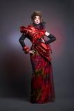 Dama w czerwieni. Fotografia Stock
