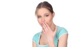 Dama z makeup zakrywa jej usta z bliska Biały tło Obraz Stock