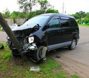 The Damage. Minibus slammed into in electric pole Stock Photo