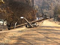 Damage caused by bushfire. Fallen pole after a bush fire Royalty Free Stock Image