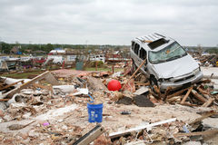 Damage after an F5 tore through Moore Oklahoma. Tornado damage after an F5 tore through Moore Oklahoma leaving a car on a pile of rubble that used to be a home stock image