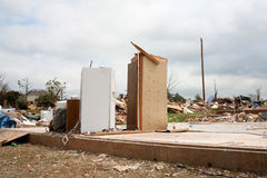Damage after an F5 tore through Moore Oklahoma. Tornado damage after an F5 tore through Moore Oklahoma leaving only a closet and refrigerator standing where a Royalty Free Stock Image