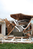Damage after an F5 tore through Moore Oklahoma. Tornado damage after an F5 tore through Moore Oklahoma tearing the side off of one home Royalty Free Stock Photos