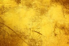 Damage golden layer texture. For background Royalty Free Stock Photo