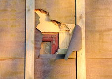 Damage on house isolation uncover window behind Stock Photos