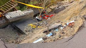 Damage from a Landslide. A road and built structures are damaged by a landslide Royalty Free Stock Photos