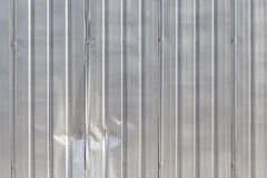 Damage metal fence. Background of damage corrugated fence at exterior of construction site royalty free stock photo