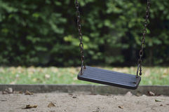 Damage metal playground swing Stock Photo