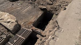 Damage of road. Dirt and broken concrete. City road needs repairing. Break old and construct new stock footage