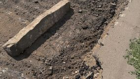Damage of road surface. Concrete pieces on the ground. Dust and dirt. City roads need capital repair stock video