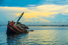 Damage ship of sunsets in thailand Stock Photography