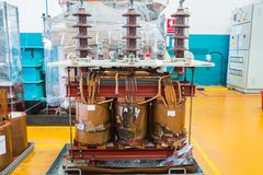 Damage three phase transformer. Damage three phase oil immersed transformer showing damage on the core and coils Stock Photos
