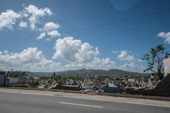 Damage to cemetery walls Caguas, Puerto Rico. Cemetery wall collapsed from the force of Hurricane Maria`s winds Royalty Free Stock Images