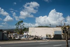 Damage to cemetery walls Caguas, Puerto Rico. Cemetery wall collapsed from the force of Hurricane Maria`s winds Royalty Free Stock Photos