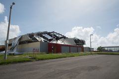 Damage to Gymnasium Roof from Hurricane Maria, Sep 2017. Aluminum roof blown off high school gymnasium by Hurricane Maria stock photography