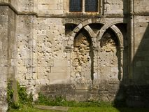 Historic Malmesbury Abbey. Damage to the walls of historic Malmesbury Abbey, Wiltshire, UK may have been caused mby Civil War musket balls Royalty Free Stock Images