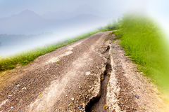 Damage unpaved roads, gravel roads, laterite roads on A Foggy Day beside the hill. Royalty Free Stock Images