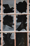 Damage window with broken glass and dark background Royalty Free Stock Photo