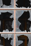 Damage window with broken glass and dark background. Royalty Free Stock Photo