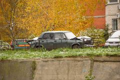 Damaged in an accident the car is parked near a brick house in the fall. Russia, Ramenskoye, October 2017.  Stock Photography