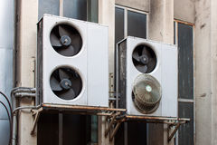 Damaged air conditioning. System assembled on side of a building Stock Photos