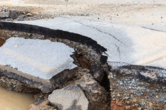 Damaged asphalt. Layer of clay that were eroded royalty free stock image