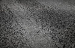 Damaged asphalt road Stock Photos