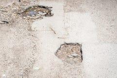 Damaged asphalt road pothole with deep holes selective focus stock images