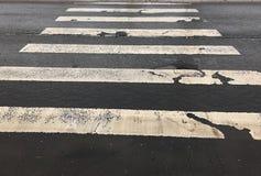 Damaged asphalt road with potholes Stock Image