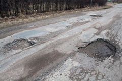 Damaged asphalt road after winter. Stock Photography