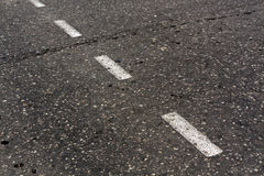 Damaged asphalt texture. Stock Photography