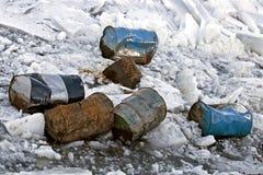 Damaged barrels in ice. stock image
