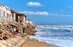 Damaged beach houses. Spain Stock Photos