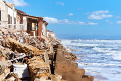 Damaged beach houses. Spain Royalty Free Stock Image