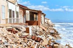 Damaged beach houses. Spain Royalty Free Stock Photo