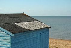 Damaged beach hut roof repair Stock Photography