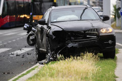 Damaged black car after accident with tram Royalty Free Stock Photos