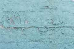 Damaged blue colored wall Stock Image