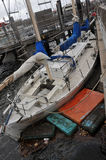 Damaged boat in the Sheepsheadbay channel. BROOKLYN, NY - OCTOBER 29: Damaged boat in the Sheepsheadbay channel due to impact from Hurricane Sandy in Brooklyn Royalty Free Stock Photography
