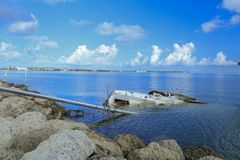 Sailboats sunk by Hurricane Irma`s wrath. Damaged boats and debris washed up along Fleming Key Cut and Trumbo Point, Key West Florida after Hurricane Irma Royalty Free Stock Photography