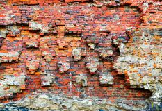 Damaged brick wall of red color. Vintage background, old weathered texture. Shabby surface of grunge masonry. Vintage facade. Damaged brick wall of red color stock photos