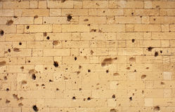 Damaged Brick Wall, textured background Stock Photography