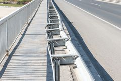 Damaged bridge, Damaged and broken security metal or iron fence on the bridge construction from car crash or traffic accident. Damaged and broken security metal stock photos